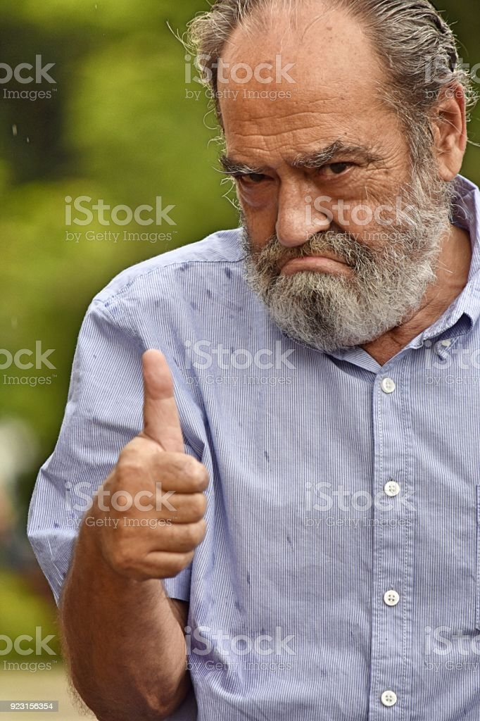 Minority Male With Thumbs Up stock photo