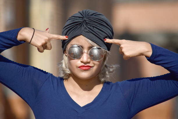 Minority Muslim Female And Confusion Wearing Turban stock photo