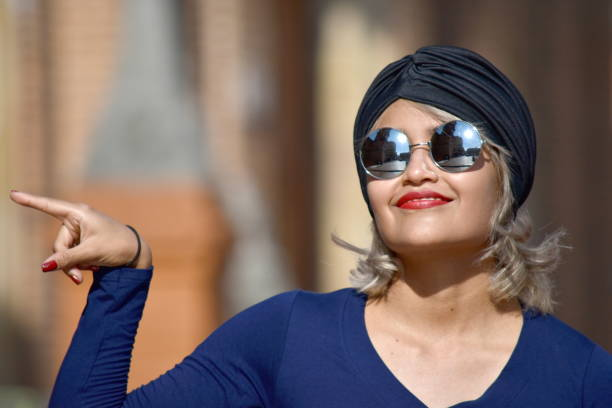 Minority Muslim Woman Pointing Wearing Turban stock photo