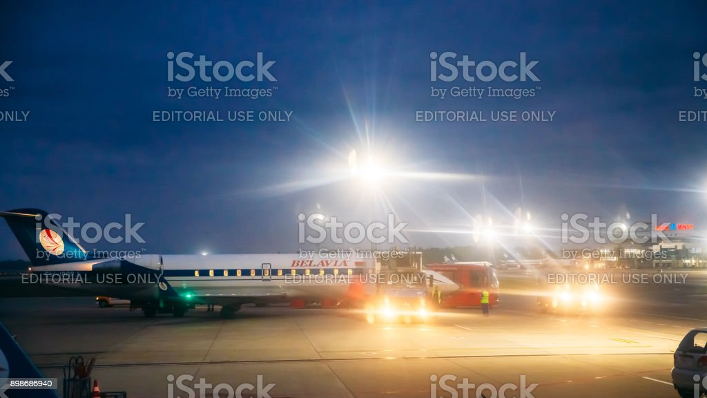 Minsk, Belarus. Aircrafts Planes Of Airlines Belavia Stand At The Minsk National Airport - Minsk-2 Terminal In Evening. stock photo