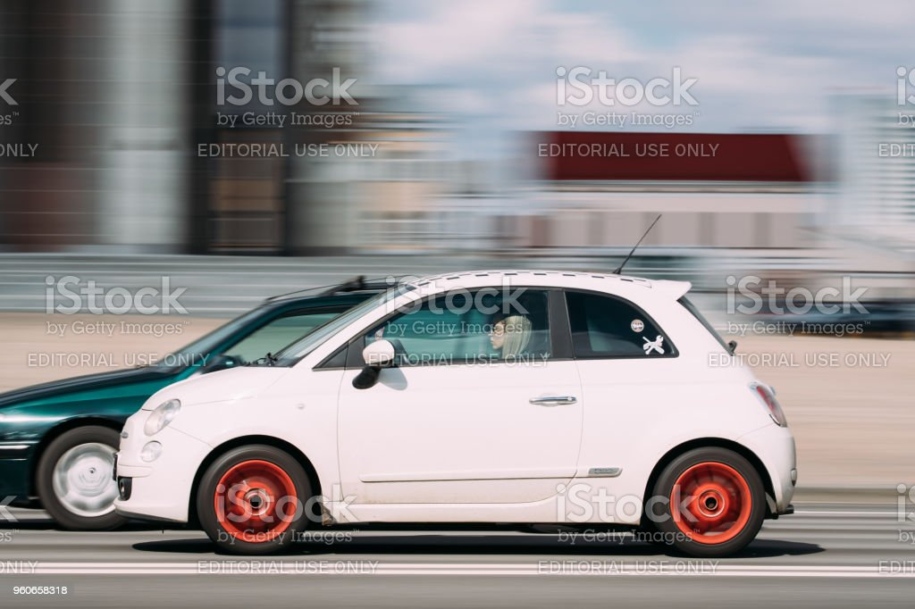 Minsk, Belarus. White Color Fiat 500 Car With Woman Driver In Fast Motion On Street stock photo