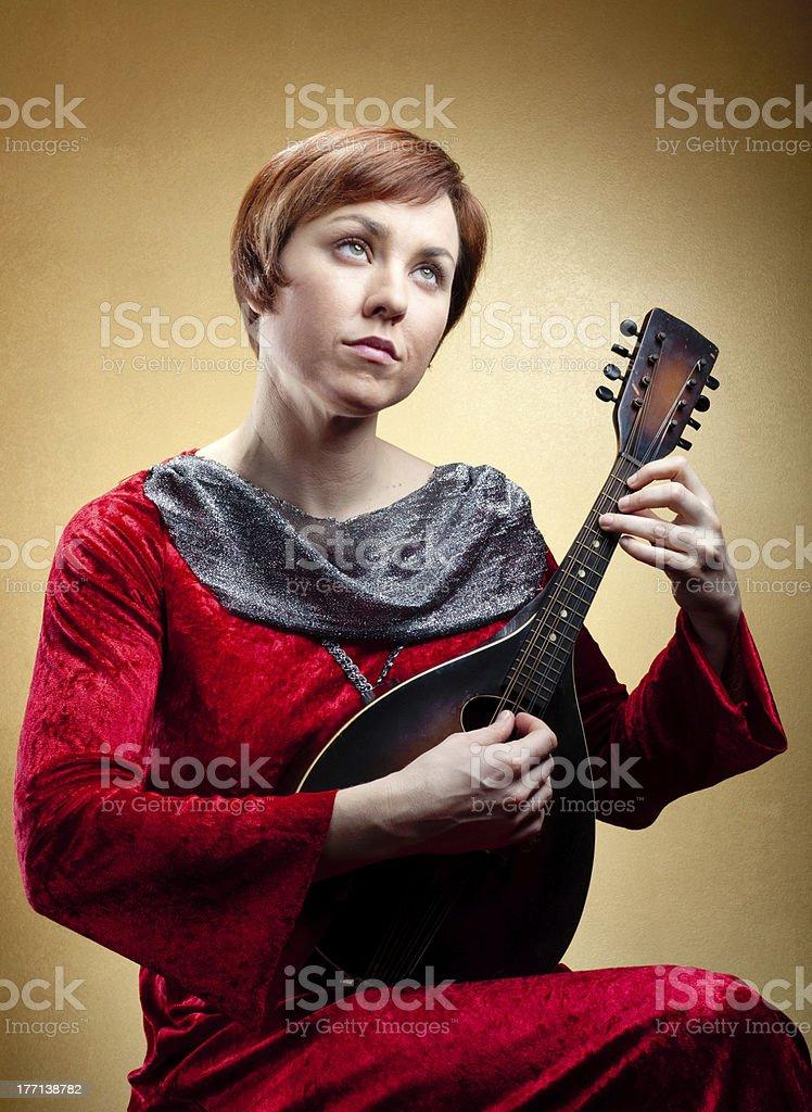 Minstrel woman with mandolin stock photo