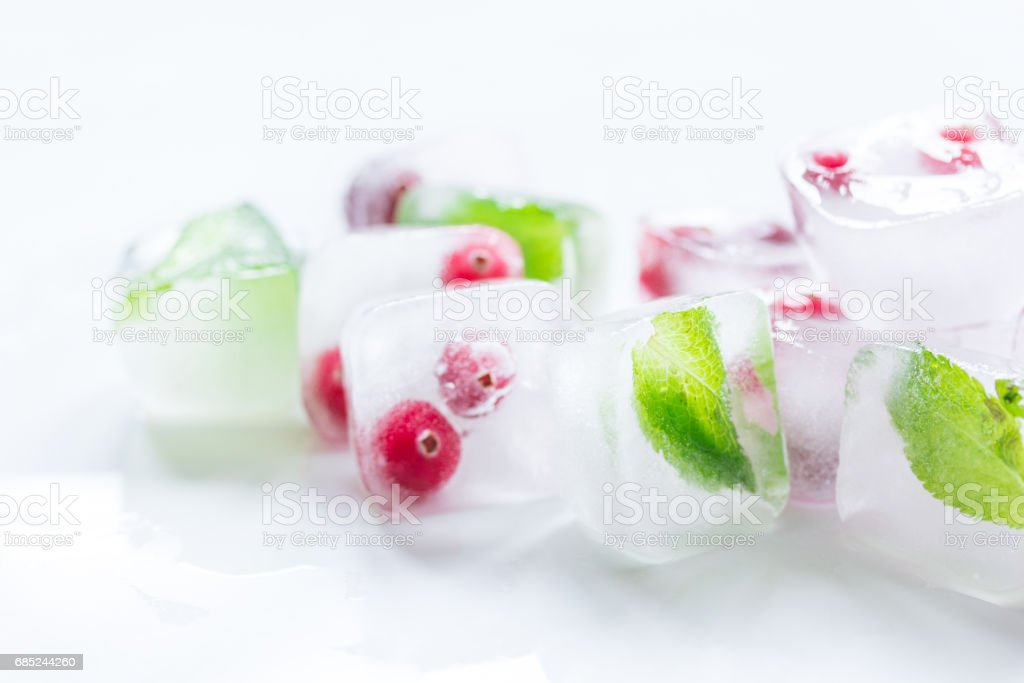 mint and red berries in ice cubes white background foto de stock royalty-free
