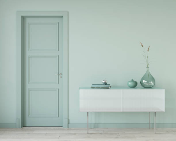 Mint color interior with a glass chest of drawers stock photo