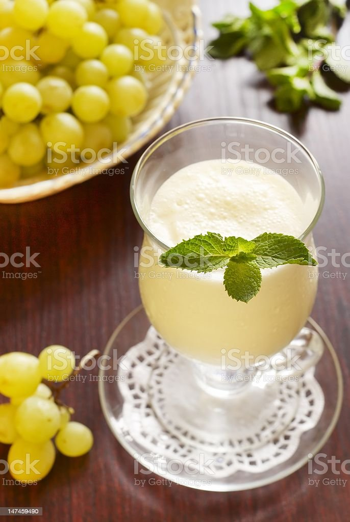 Mint ginger cocktail with milk and grapes royalty-free stock photo