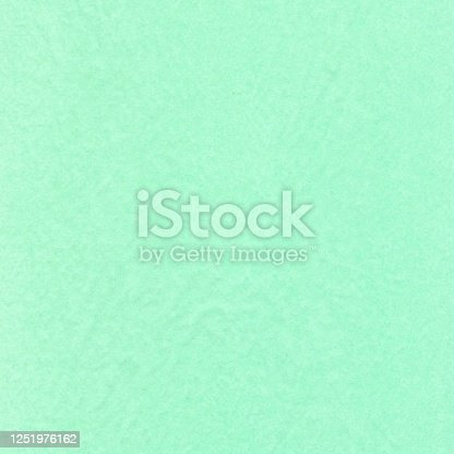 527392693 istock photo Mint green giftwrap paper texture or background 1251976162