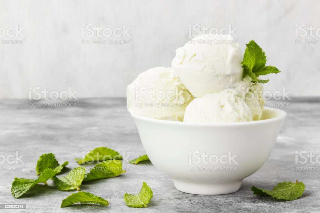 Mint ice cream in bowl on a gray background. Copy space. Food background stock photo