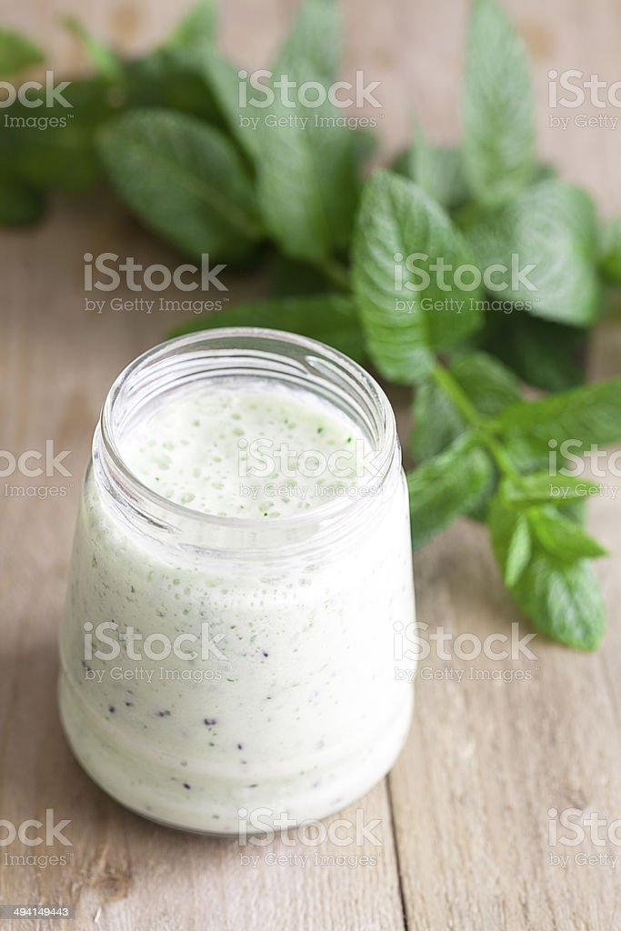 mint leaves and a glass of smoothie royalty-free stock photo