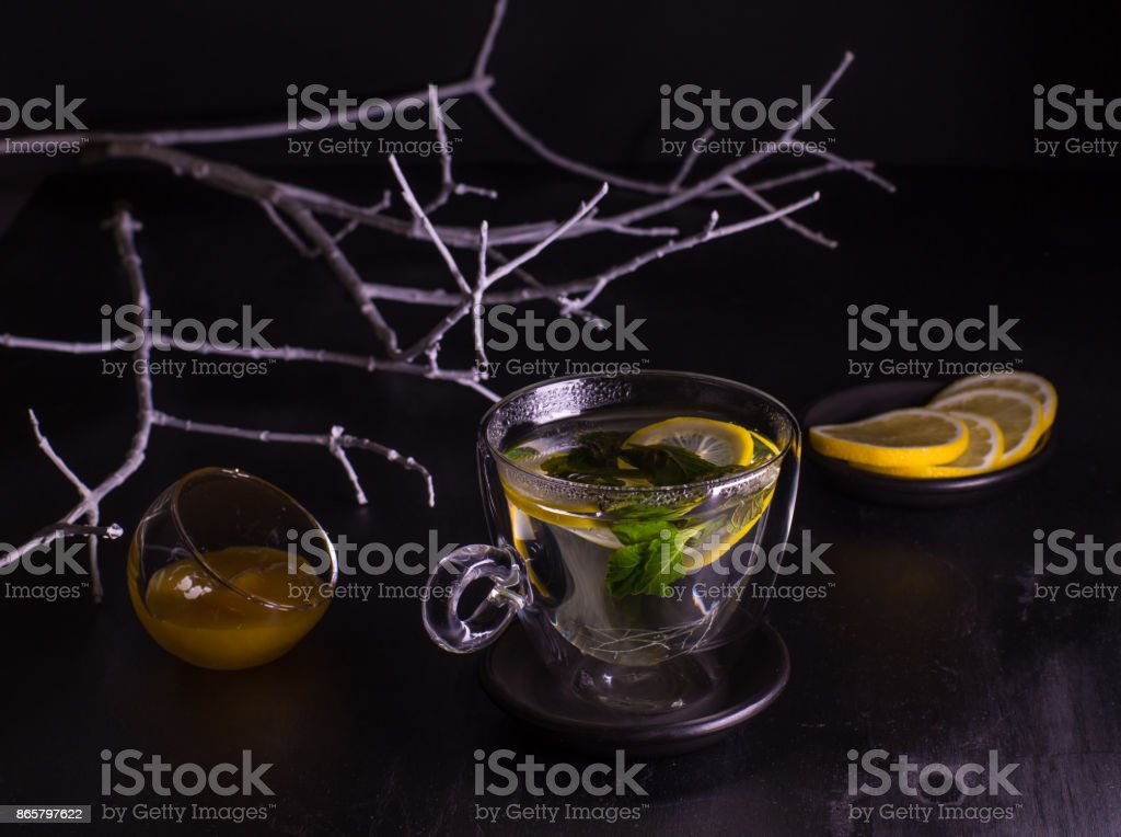 Mint lemon tea on a dark background stock photo