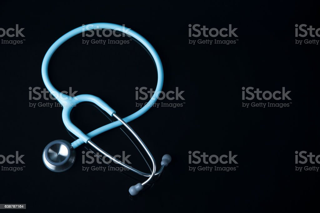 Mint Stethoscope close up view. Blue color Stethoscope with reflection. stock photo