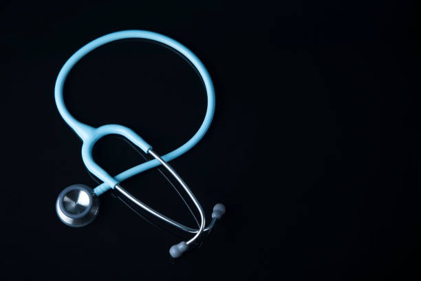 Mint Stethoscope close up view. Blue color Stethoscope with reflection.