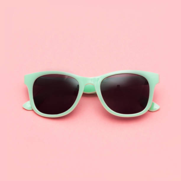 Mint sunglasses isolated on pink background. Closeup. stock photo