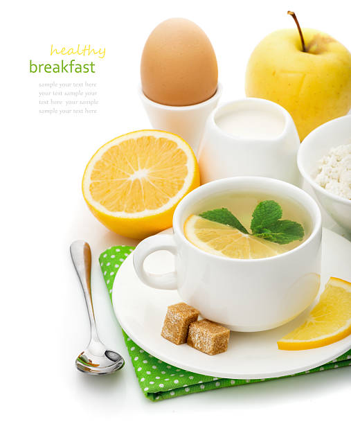 Mint tea with lemon and healthy breakfast stock photo
