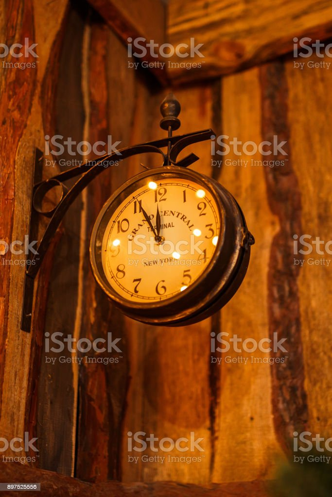 Minute before the new year on retro clock stock photo