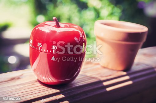 1048940572 istock photo 30 Minute Kitchen Egg Timer in Apple Shape On Handrail 595160700