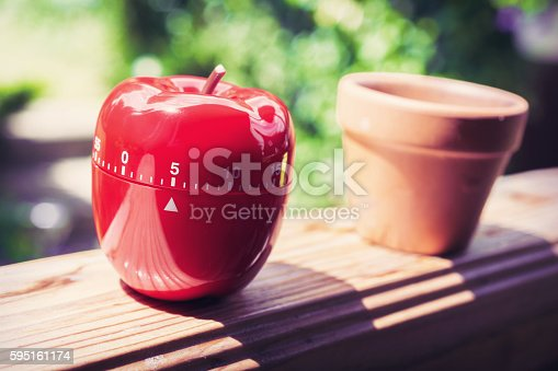 1048940572 istock photo 5 Minute Kitchen Egg Timer in Apple Shape On Handrail 595161174