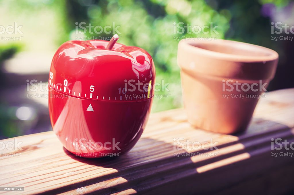 5 Minute Kitchen Egg Timer in Apple Shape On Handrail stock photo