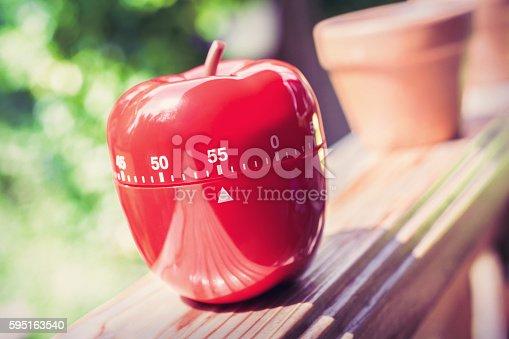 istock 55 Minute Kitchen Egg Timer in Apple Shape On Handrail 595163540