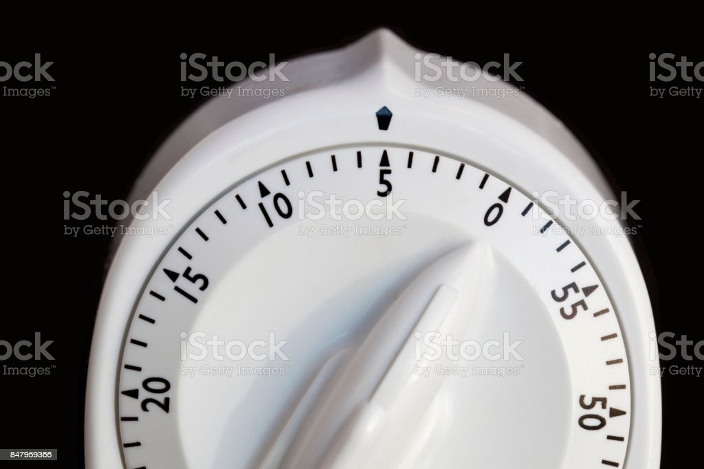 minute timer with five minutes to go on black background stock photo