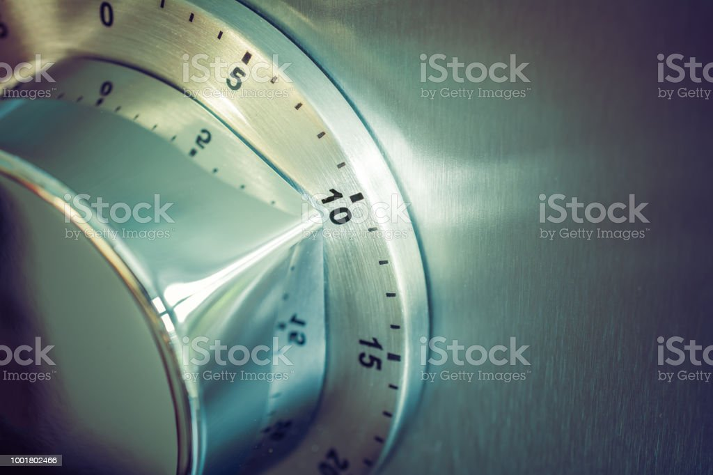 10 Minutes Analog Chrome Kitchen Timer Placed On A Refrigerator