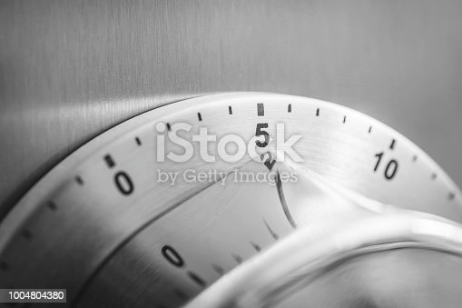 1048940572 istock photo 5 Minutes - Analog Chrome Kitchen Timer Placed On A Refrigerator 1004804380