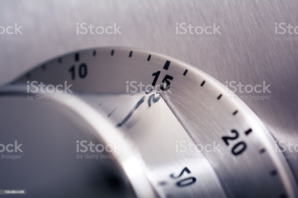 15 Minutes - Analog Chrome Kitchen Timer Placed On A Refrigerator stock photo