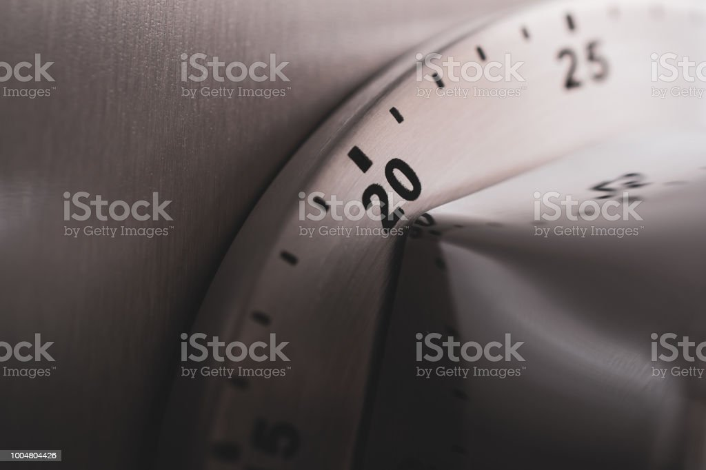 20 Minutes - Analog Chrome Kitchen Timer Placed On A Refrigerator stock photo