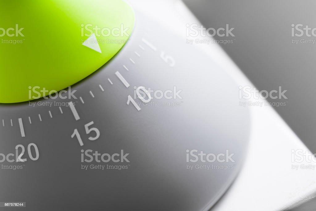 10 Minutes - Analog Green / Grey Kitchen Egg Timer On White Table stock photo