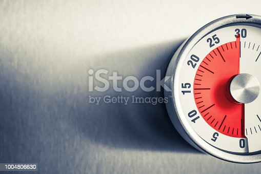 30 Minutes - An Analog Kitchen Timer With Red Mark Placed On A Fridge In Monochrome Colors
