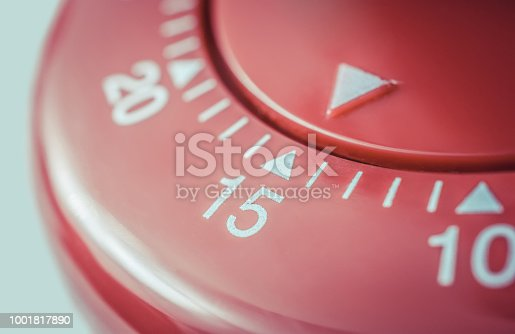 1048940572 istock photo 15 Minutes - Macro Of A Flat Red Kitchen Egg Timer 1001817890