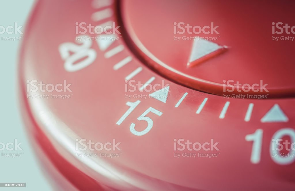 15 Minutes - Macro Of A Flat Red Kitchen Egg Timer stock photo
