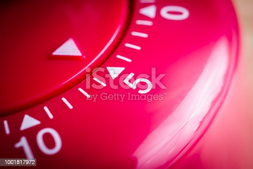 1048940572 istock photo 5 Minutes - Macro Of A Flat Red Kitchen Egg Timer 1001817972