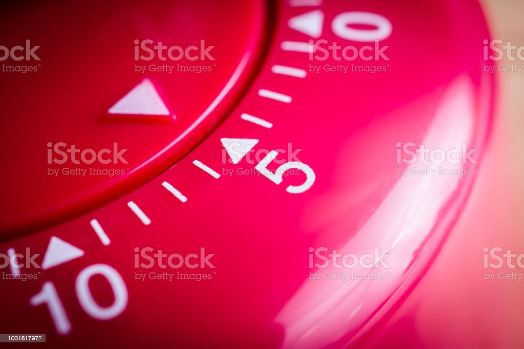 5 Minutes - Macro Of A Flat Red Kitchen Egg Timer stock photo