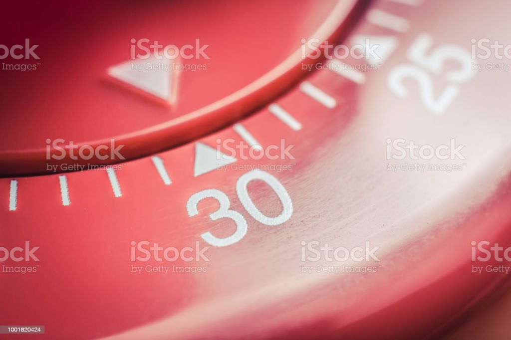 30 Minutes - Macro Of A Flat Red Kitchen Egg Timer stock photo