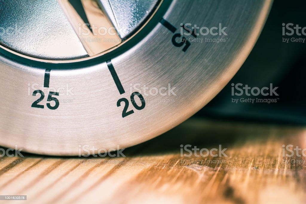 20 Minutes - Macro Of An Analog Chrome Kitchen Timer On Wooden Table stock photo