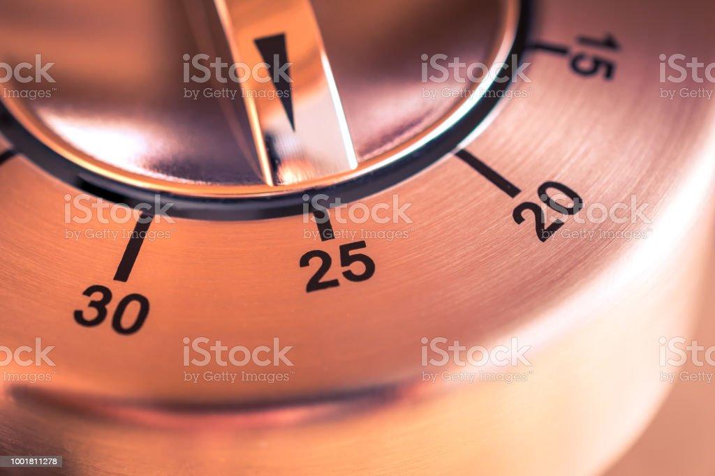 25 Minutes - Macro Of An Analog Chrome Kitchen Timer stock photo