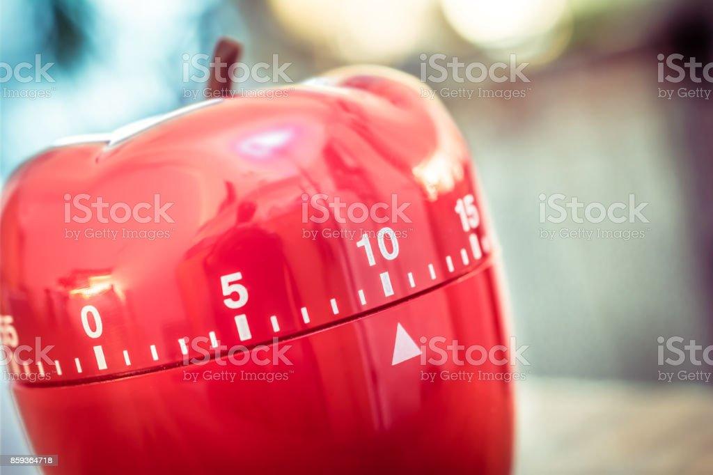10 Minutes - Red Kitchen Egg Timer In Apple Shape On A Table stock photo