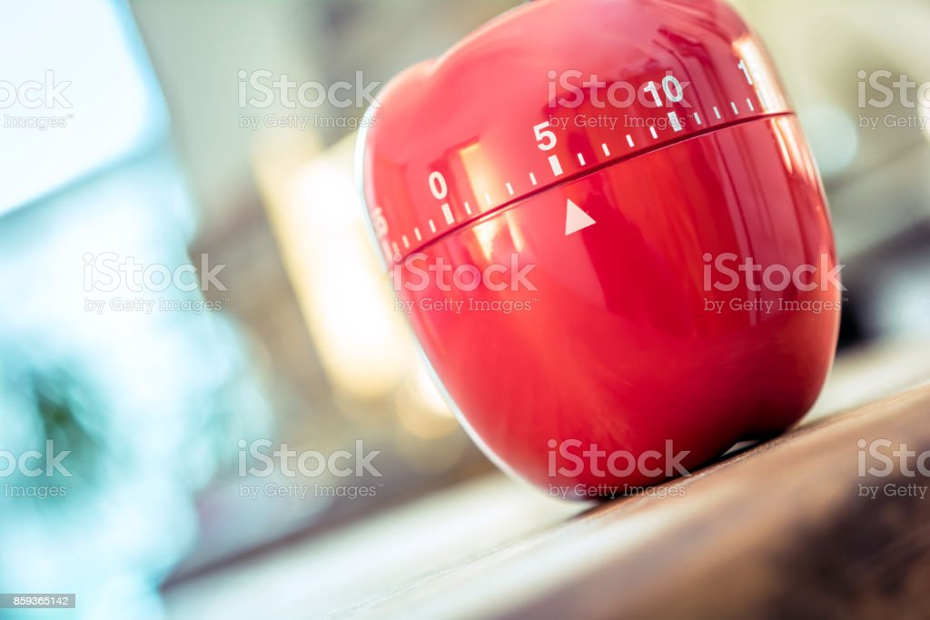 5 Minutes - Red Kitchen Egg Timer In Apple Shape On A Table stock photo