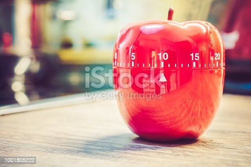 1048940572 istock photo 10 Minutes - Red Kitchen Egg Timer In Apple Shape On Countertop 1001805222