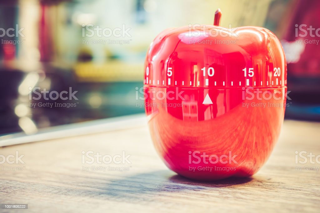 10 Minutes - Red Kitchen Egg Timer In Apple Shape On Countertop stock photo