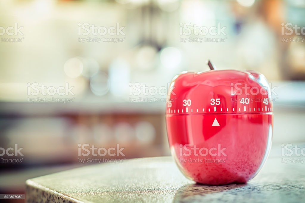 35 Minutes - Red Kitchen Egg Timer In Apple Shape stock photo