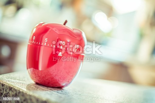 1048940572 istock photo 10 Minutes - Red Kitchen Egg Timer In Apple Shape 592651848