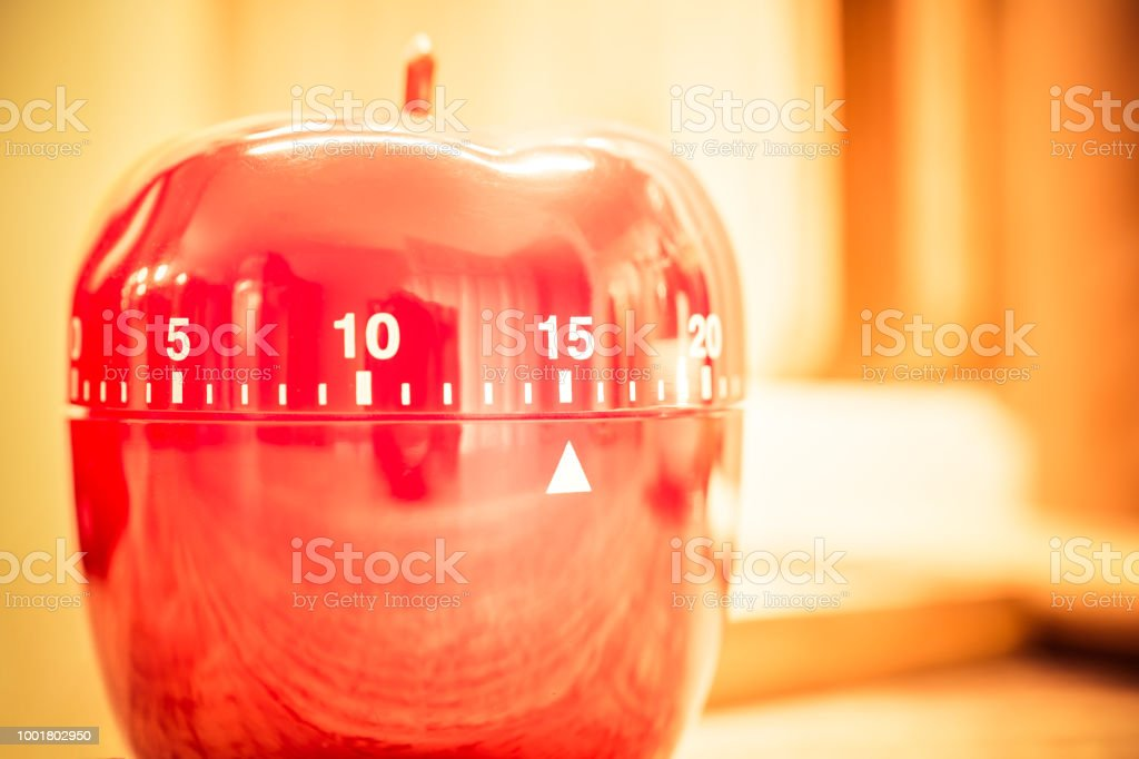 15 Minutes - Red Kitchen Egg Timer In Bright Atmosphere stock photo