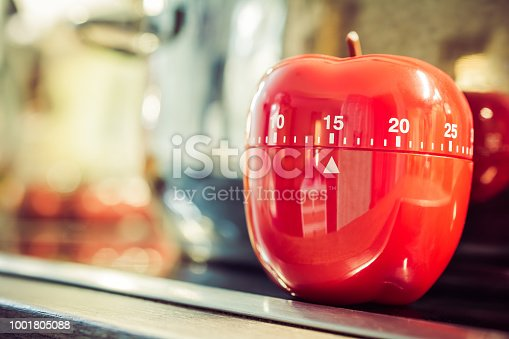 1048940572 istock photo 15 Minutes - Red Kitchen Egg Timer On Cooktop Next To A Pot 1001805088