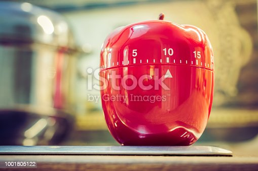 1048940572 istock photo 10 Minutes - Red Kitchen Egg Timer On Cooktop Next To A Pot 1001805122