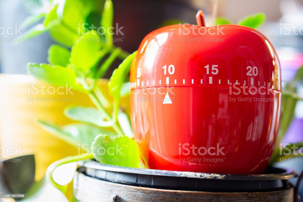 10 Minutes Red Kitchen Egg Timer Placed On A Flowerpot Stock Photo