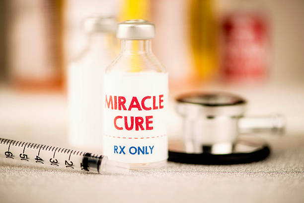 Miracle cure vaccine with syringe and stethoscope stock photo