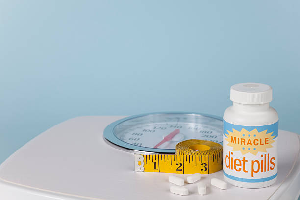 Miracle Diet Pills, Scale and Measuring Tape stock photo
