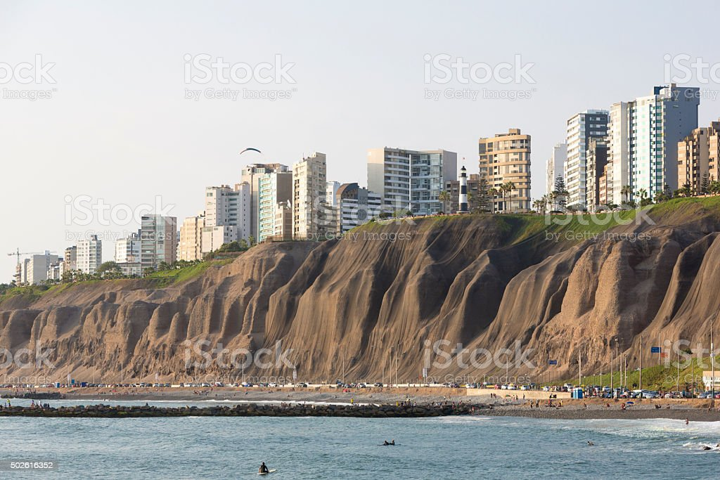 Miraflores with residential buildings and people on the beach stock photo