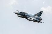 FLORENNES, BELGIUM - JUN 15, 2017: French Air Force Dassault Mirage 2000 fighter jet flyby over Florennes Airbase